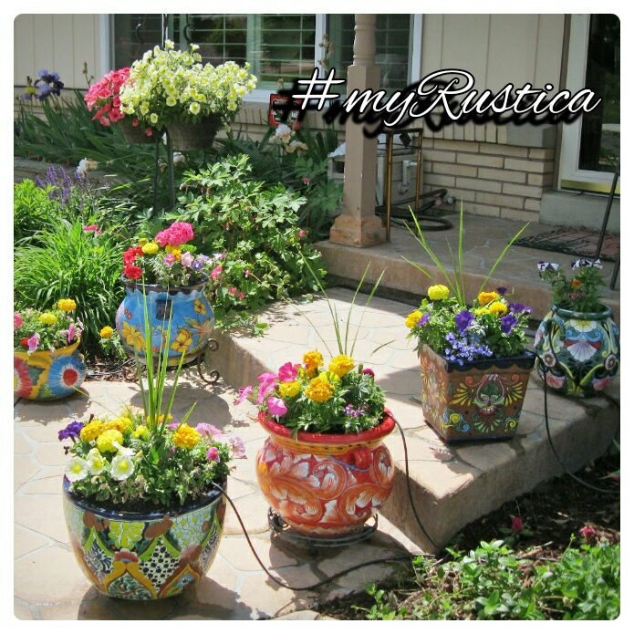 rustic garden,rustic garden, patio and veranda furniture handmade in iron as well as cast aluminum, hand painted talavera pottery from Mexico, decorative bird feeders and outdoor lighting